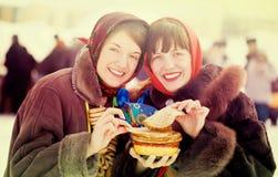 Young women eating pancake Stock Photo