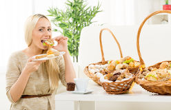 Young Women Eating Pastries Royalty Free Stock Images