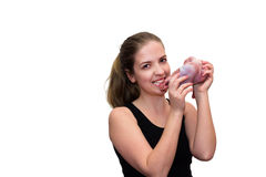 Young women eating a piece of fresh meat Royalty Free Stock Image