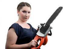 Young women with electric saw Stock Photos
