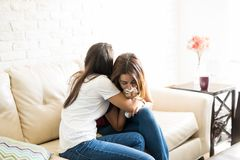 Comforting a crying friend Stock Images