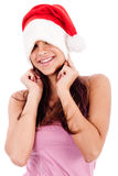 Young women embrassing wearing santa's hat Royalty Free Stock Photography
