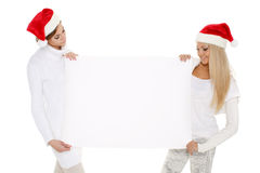 Young  women with empty board for the text. Royalty Free Stock Photography