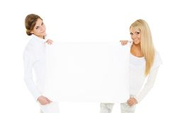Young  women with empty board for the text. Stock Image