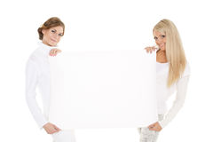 Young  women with empty board for the text. Stock Photos
