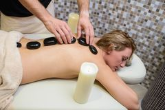 Young woman enjoy and relax in spa center. Young women enjoy and relax in spa center,hot rocks and sauna Stock Photo