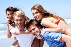Young women enjoying piggyback ride royalty free stock images