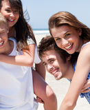 Young women enjoying piggyback ride Royalty Free Stock Photography