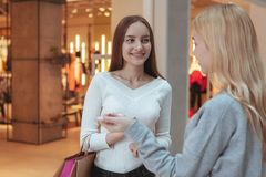 Young women enjoying shopping together at the mall royalty free stock photography