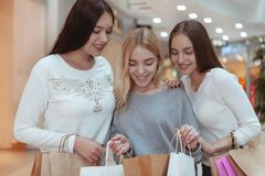 Young women enjoying shopping together at the mall royalty free stock image