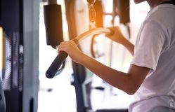 Young women exercise in a professional gym with a selection of e. Xercise equipment royalty free stock photography