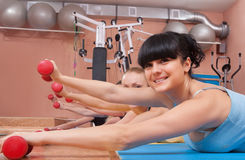 Young women exercising with dumbbells Royalty Free Stock Images