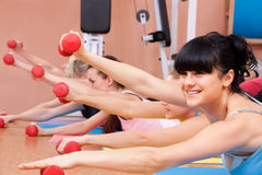 Young women exercising with dumbbells Stock Photos