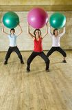 Young women exercising with fitness ball Stock Photo