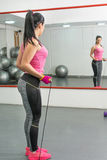 Young women exercising in the gym royalty free stock photo