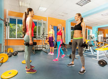 Young women exercising in the gym class Royalty Free Stock Image