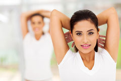 Woman exercising indoors Stock Photography