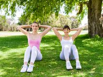 Young women exercising in the park. Healthy and fit young women doing fitness and Exercise in the park Royalty Free Stock Photo