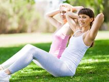 Young women exercising in the park. Healthy and fit young women doing fitness and Exercise in the park Stock Photo
