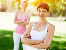 Young women exercising in the park. Healthy and fit young women doing fitness and Exercise in the park Stock Image