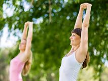 Young women exercising in the park. Healthy and fit young women doing fitness and Exercise in the park Stock Photography