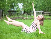 Young women falling on grass Royalty Free Stock Photo