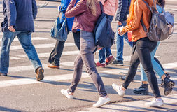 Young Women Feet, Crossing An Urban Street Royalty Free Stock Image