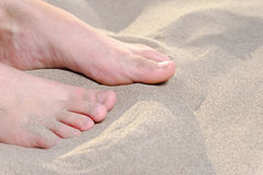 Young women feet on sand a lot of space for text Stock Image