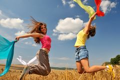 Young women on field in summer Royalty Free Stock Image
