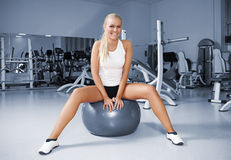 A young women on a fitness ball Stock Photography