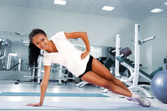 Young woman at the fitness club stock photography