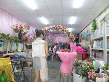 Young women in the flower shop to tidy up roses. In Shenzhen, china Stock Image