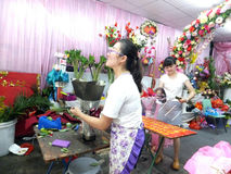 Young women in the flower shop to tidy up roses. In Shenzhen, china Royalty Free Stock Image