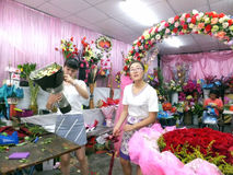 Young women in the flower shop to tidy up roses. In Shenzhen, china Royalty Free Stock Photography