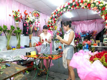 Young women in the flower shop to tidy up roses. In Shenzhen, china Stock Images