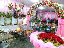 Young women in the flower shop to tidy up roses. In Shenzhen, china Royalty Free Stock Photo