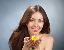 Young women with flowers Royalty Free Stock Photos