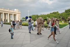 Young women followed by two persons dressed like animals. Event: Football and Music Festival Art-football. Date: May 27, 2016. Location: Gorky recreation park Stock Photography