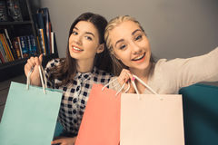 Young women friends in a coffee shop free time Royalty Free Stock Image