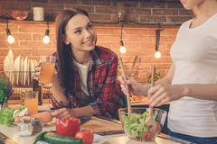 Young women friends cooking meal together at home Stock Image