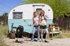 Young Women in Front of a Trailer Royalty Free Stock Photo