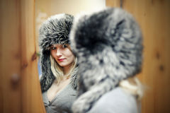 Young women in fur hat Royalty Free Stock Image