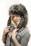 Young women in fur hat Stock Photography