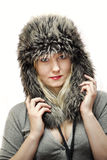 Young women in fur hat Stock Images