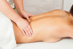 Young women getting back massage Royalty Free Stock Images