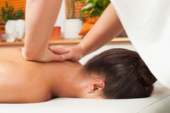 Young women getting back massage Stock Photos