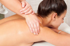 Young women getting back massage Stock Images