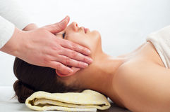 Young women getting a face massage Royalty Free Stock Photo