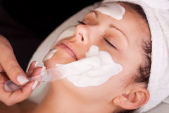 Young women getting facial mask Stock Photos