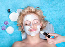 Young women getting facial mask. royalty free stock images